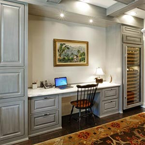 Large home office surrounded by Amish made cabinets by Schlabach Wood Design